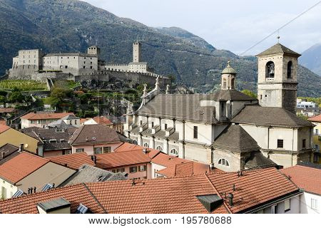 Bellinzona, Switzerland - 3 August 2010: The Collegiate Church and fort Castelgrande at Bellinzona on the Swiss alps Unesco world heritage