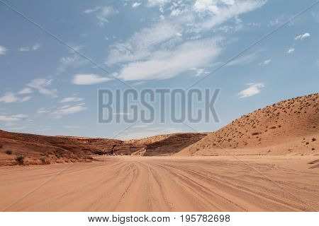 The wide view of desert with cars and blue sky
