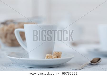 Photo Coffee Cup And Sweets In A Light Key Concept. Still Life In White