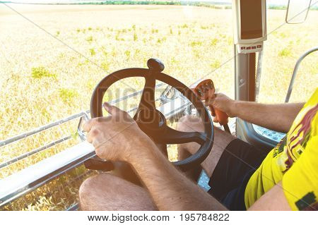View from the cab of a combine harvester and the farm manager of the combine harvester