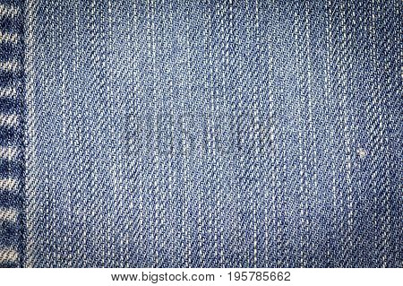 Denim jeans fabric texture background with seam for beauty clothing, fashion business design and industrial construction idea concept.