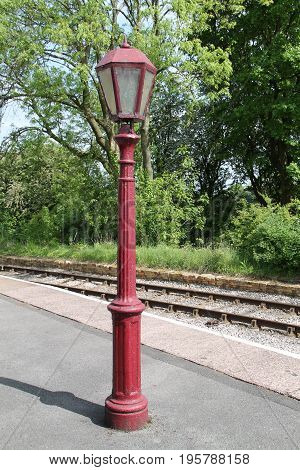 A Vintage Lamp Post on a Railway Train Station Platform.
