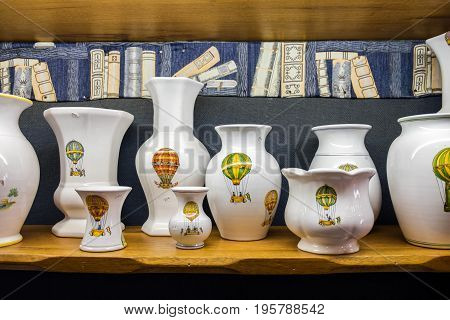 MOUSTIERS-SAINTE-MARIE FRANCE - JUNE 20 2017: Painted provence traditional pottery sold in souvenir shop