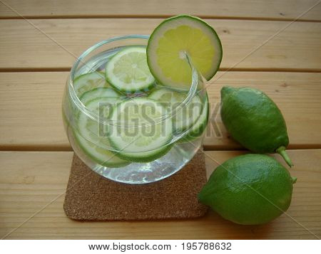 Lime water in the round glass bowl with sliced lime.