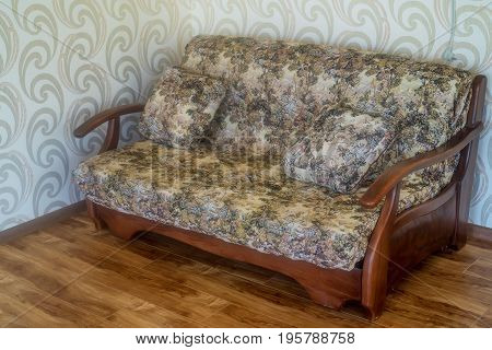 Close up sofa with cushions in room part of interior