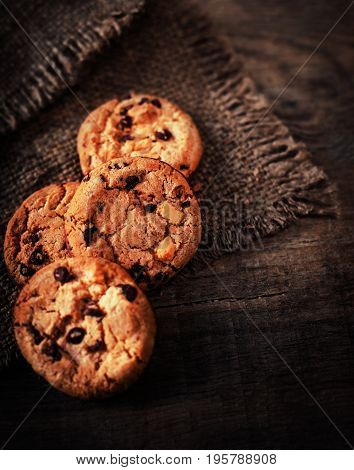 Fresh Chocolate chip cookies on dark old wooden table with place for text. freshly baked. Selective Focus with Copy space.