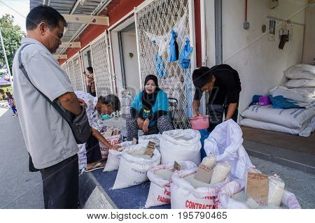 Keningau,Sabah,Malaysia-June 29,2017:Local people buying varieties of rice on the local market Tamu in Keningau,Sabah.Its a place where all farmers & vendors gathers weekly to sell their products