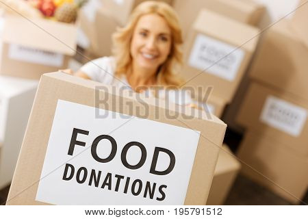 Good nutrition for everyone. Emotional pretty graceful lady helping her community and working pro bono while accepting donations from people