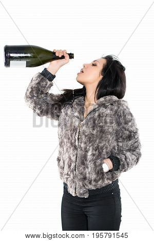 Portrait of sexy brunette wearing furry jacket with a big bottle. Isolated on white