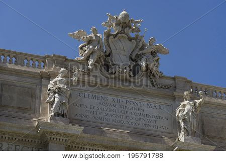 Trevi Fountain (Fontana di Trevi) in Rome Italy. Trevi is most famous fountain of Rome. Architecture and landmark of Rome Postcard of Rome.