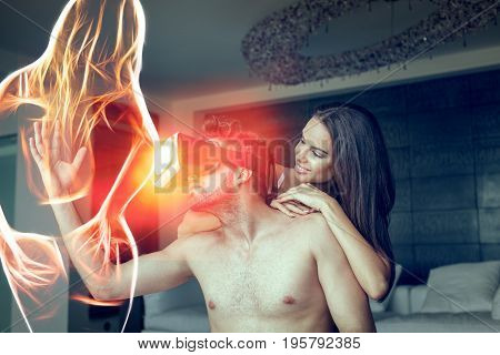 Young naked couple playing with VR glasses and fiery virtual lover silhouette at home