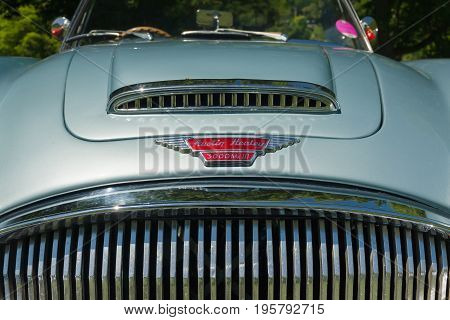 Llangollen Wales UK - July 1 2017: Austin Healey 3000 Mark 3 bonnet badge an iconic classic British sports car built from 1959 to 1967 at a vintage vehicle rally