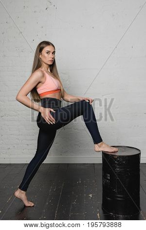 Beautiful Young Woman Doing Exercises At Home.