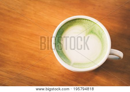Green tea cup in cafe shop time to relaxing hipster tone and soft of focus