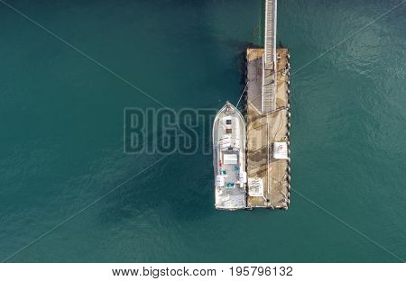 Aerial image of a boat at a floating dock in the summer