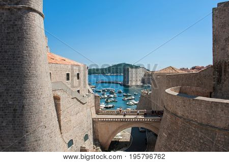 DUBROVNIK, CROATIA - AUG 3, 2016: tourists in the old port of Dubrovnik, Croatia. Dubrovnik is a UNESCO World Heritage site
