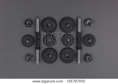 Flat Lay With Various Metal Barbells And Weight Plates Isolated On Grey