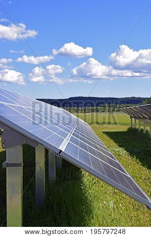 Solar panel, side view. Beautiful sky on background. Vertical image.