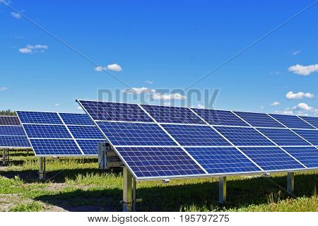 Solar panels. Clear bue sky on background, with room for text.