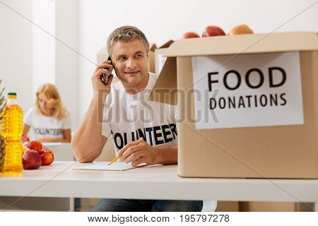 Can you confirm that. Altruistic diligent devoted man working for charity institution and sending foods to those in need while calling for confirmation