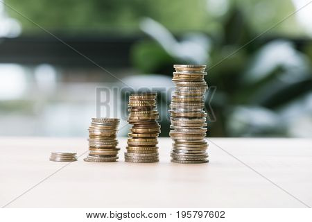 Selective Focus Of Low And High Stacks Of Coins On Table