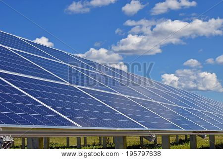Close up of solar panels. Beautiful cloudy sky on background.