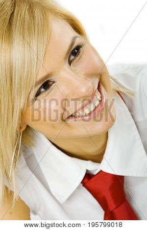 Young smiling businesswoman nicely dressed in a white shirt and a red necktie, smiling