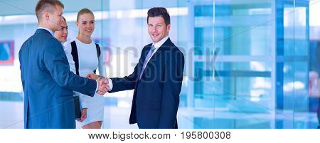 Image of two successful business men shaking hands with each other