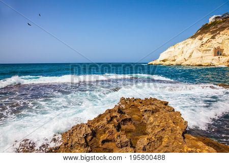 The grottoes of Rosh Ha Nikra. Rocks of white limestone on the shores of the Mediterranean Sea. Geological phenomenon in the north of Israel, on the border with Lebanon