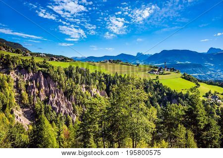 The charming small village in the Dolomites. Magical Tirol, Italy. Renon's earth pillars at sunrise. The concept of ecological tourism