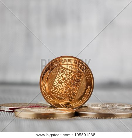 Digital currency physical gold titan bitcoin coin on the gold money. Silver background. poster