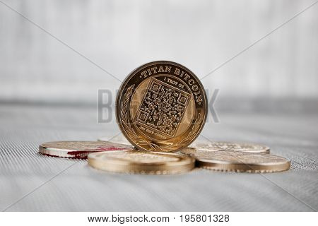 Digital currency physical gold titan bitcoin coin on the money. Business concept. poster