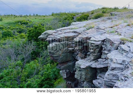Summer Landscape With Rocky Ledge Cliff