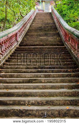 Stairway going up to the buddhist temple in jungle forest. The Path to Enlightenment.