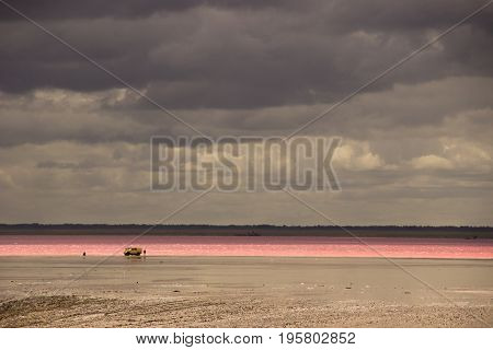 Salt Lake in the desert and cloudy sky