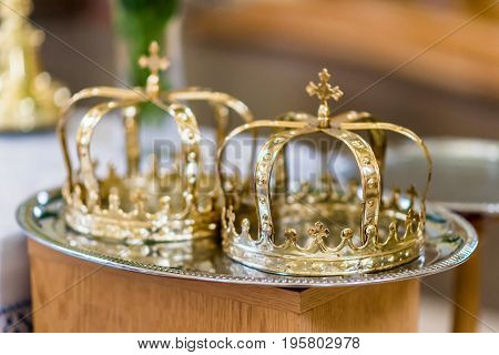 Two crowns before the wedding ceremony in church
