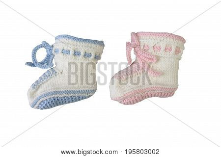 Newborn concept - Color (gender) Boy and girl. Knitted baby booties on white background