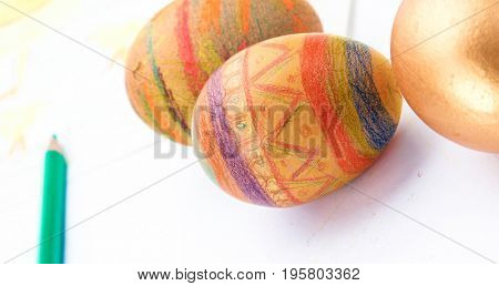 Golden egg on yellow background