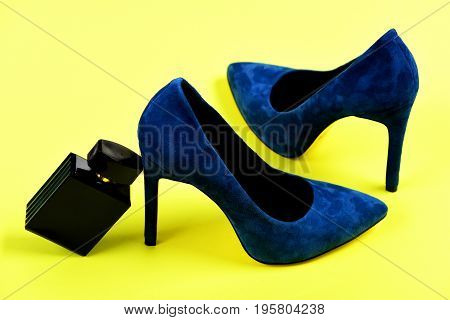 Shoes In Dark Blue Color With Bottle Of Perfume