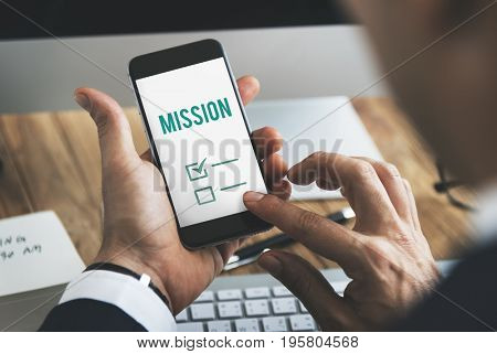 Businessman close up mobile phone with check list