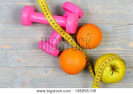 Dieting Food Concept, Dumbbells Weight With Measuring Tape ,fruit
