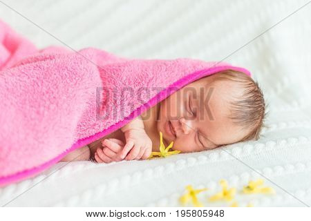 Portrait of newborn baby girl princess with crown on soft white blanket.
