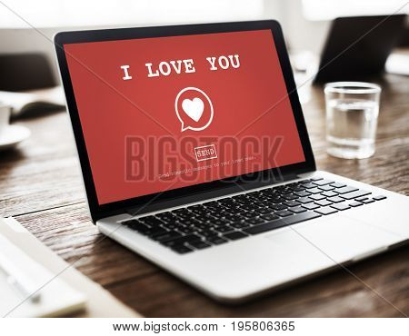 I Love You heart symbol on red laptop screen