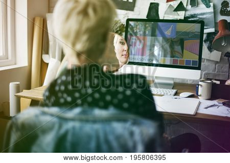 Fashion designer with mirror on her workplace