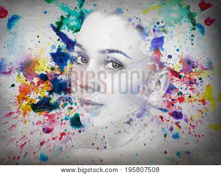 Double exposure portrait of young woman and watercolor paint over gray wall.