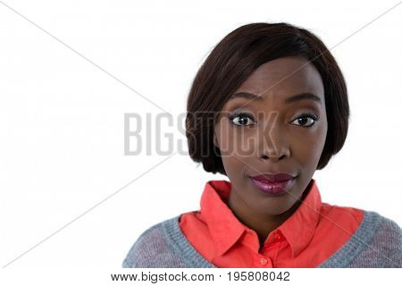 Close up portrait of surprised young woman against white background