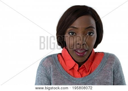 Close up portrait of surprised woman against white background