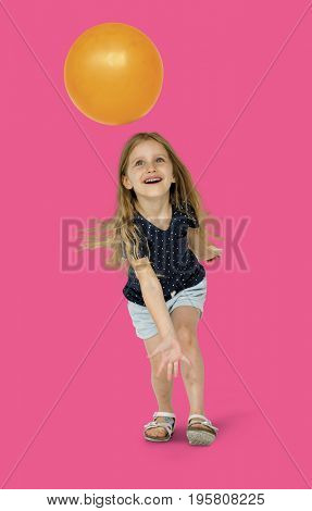 Young caucasian girl with an orange ball