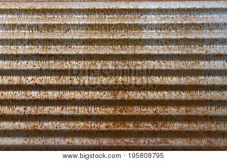 corrugated metal that is rusted from being out in the weather