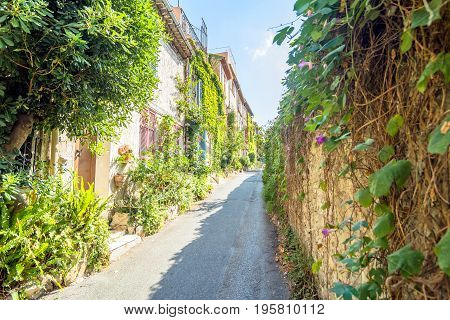 Antibes, France - July 01, 2016: day view of typical narrow street in Antibes France. Antibes is a popular seaside town in the heart of the Cote d'Azur.